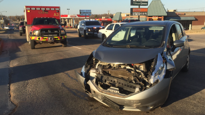 Wreck halts traffic for several minutes on S. Division St.