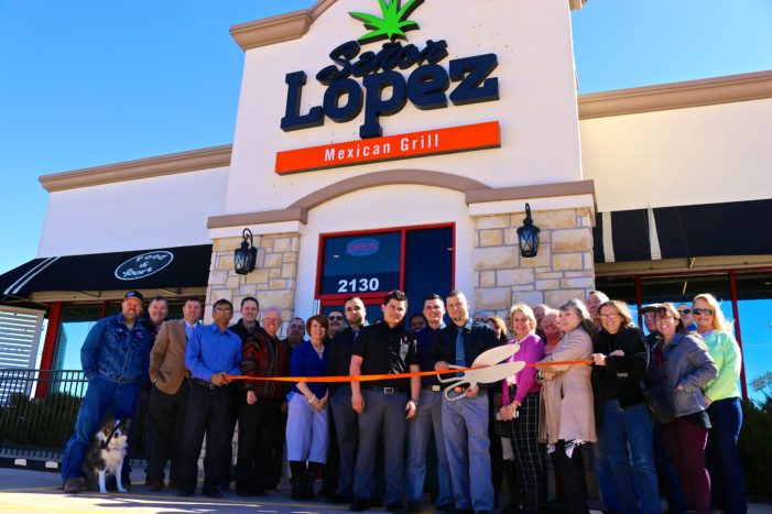 Senor Lopez cuts the ribbon and opens their doors