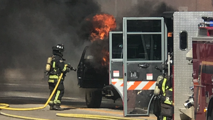Truck erupts in flames on Division St.