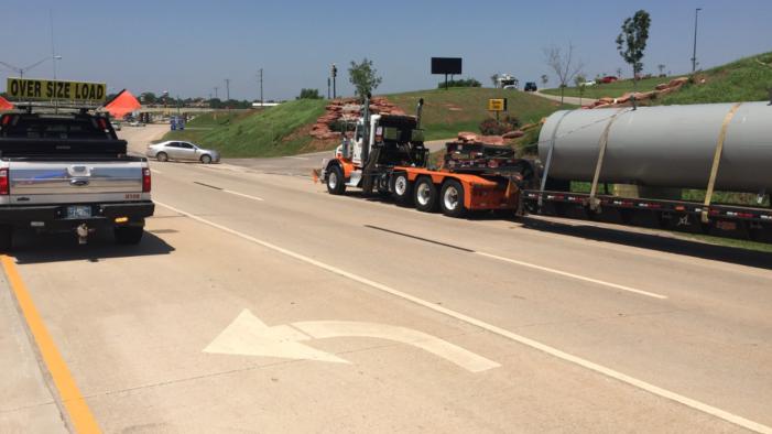 Video: Oversize semi-truck clips power line; shuts down Highway 33