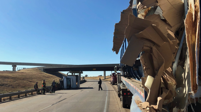Mechanic avoids injuries after box top truck smashes into semi-truck