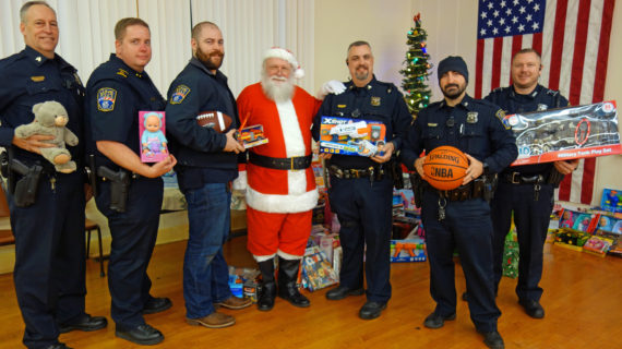 American Legion Post and Guthrie Police play Santa