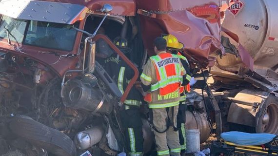Semi-truck driver avoids vehicle, smashes into guardrail