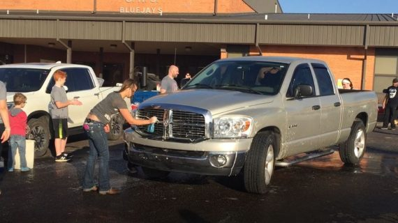 Hundreds attend car wash fundraiser for local families