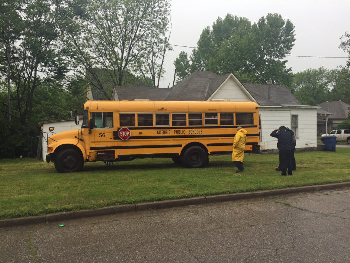 Collision sends school bus into front yard; one person arrested