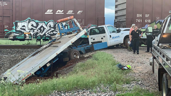 Wrecker truck clipped by train