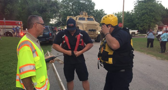 MRAP helps rescue three people from flood waters